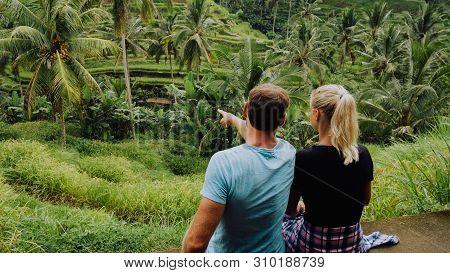 Happy Couple Explore Tegalalang Rice Terraces Near Ubud, Bali, Indonesia. Summer Travel Vocation Con