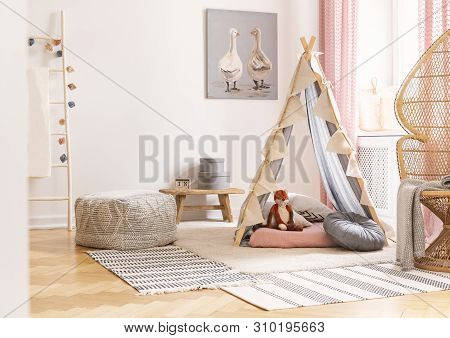 Wicker Peacock Chair Next To Tent With Pillows And Pouf In Scandinavian Designed Girl's Playroom, Re