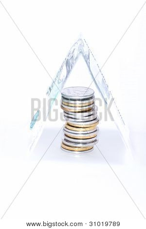 Stack of coins covered banknot