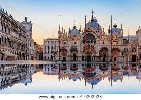 Sunrise In San Marco Square With Campanile And San Marco's Basilica. The Main Square Of The Old Town