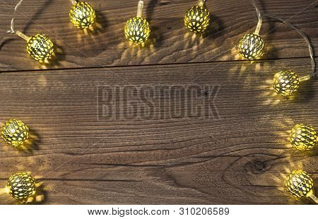 The Photo Shows A Rustic Background With Little Lamps Arranged As A Frame