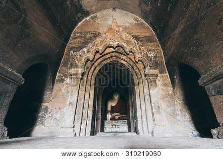 Interior Of Burmese Buddhist Temple With Buddha Statue In Bagan, Myanmar. Wide Angle Lens Shot.