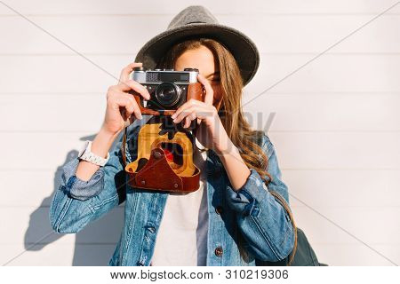 Close-up Portrait Of Charming Female Photographer Making New Photos Outside With Old Professional Ca