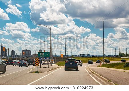 Beautiful Landscape Midday View Of Toronto City Highway Street With Cars Traffic During Sunny Day Wi