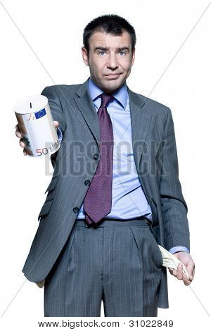Portrait of businessman holding money box and showing empty pocket in studio on isolated white background