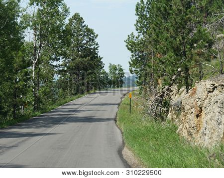 Scenic Drive Along A Winding Sloping Road At Needles Highway In South Dakota.