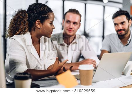 Successful Group Of Casual Business Discussing And Working With Laptop Computer.creative Business Pe