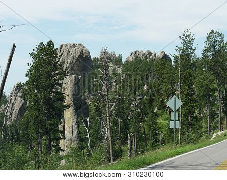 Medium Close Up Of Towering Granite Rock Formations Along Needles Highway In South Dakota.