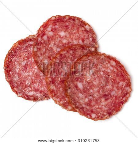 Slices of salami isolated on white background closeup. Sausage top view.