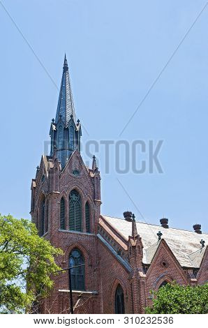 Historic Church Bell Tower And Steeple Of Gothic Revival Architectural Style In New Orleans Louisian