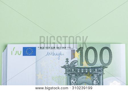Euro Cash On A Green Background. Euro Money Banknotes. Euro Money. Euro Bill. Place For Text.