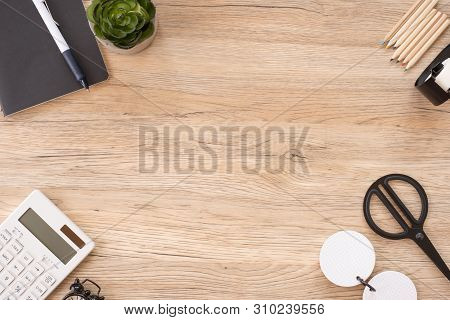 Top View Office Stationery On Wooden Table With Copy Space.student Stuff On Desk.education Concept