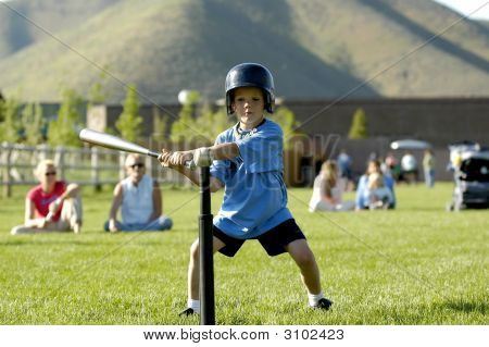 Boy Playing T Ball