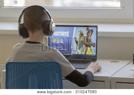 Vilnius, Lithuania - March 2, 2019: Child Playing Fortnite Game. Fortnite Is Popular Online Video Ga