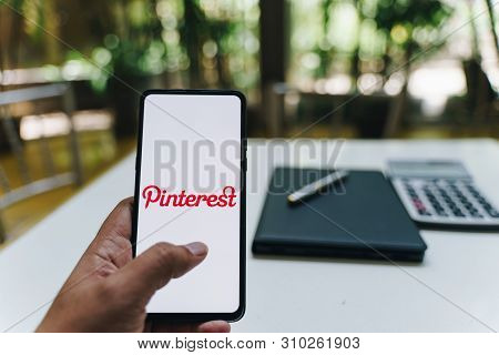 Chiang Mai, Thailand - May.26,2019: Man Holding Xiaomi Mi Mix 3 Mobile Phone With Pinterest Apps Log
