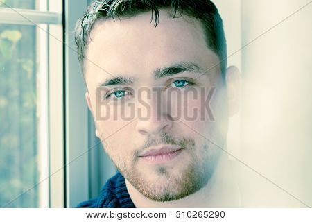 Portrait Of Handsome Man Withbeard Sitting In Window