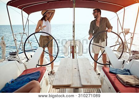 happy couple on the luxury boat enjoy on vacation together