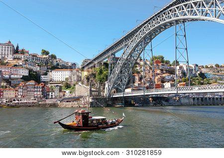 Porto, Portugal: Retro Riverboat Sailing On The River Douro, Under Famous Double-deck Metal Arch Bri