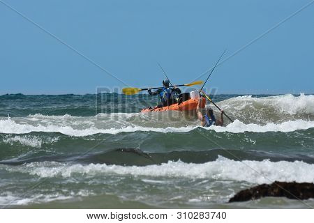 Fishermen With Ocean Kayak In The Waves, Mossel Bay, South Africa
