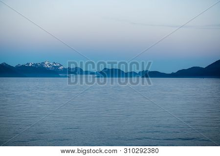 A Late Evening Mist Over Resurrection Bay In Seward Alaska.