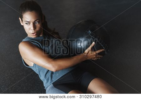 High Angle View Focused Motivated Strong Woman Workout Sitting Gym Floor, Breathing Determined, Trai