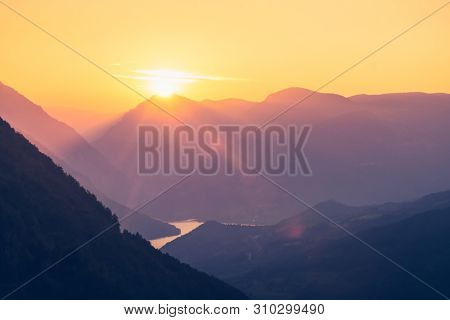 Sunset In Mountain Landscape. Mountain Layers In Sunset. Sunset In The Mountain River Landscape. Riv