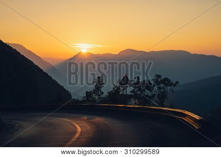 Sunset In Mountain Landscape. Mountain Layers In Sunset. Sunset In The Mountain Road Landscape. Road