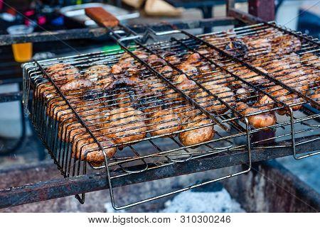 Champignons Preparing In Barbecue Grill On Picnic