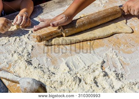 Woman Rolling Dough With The Rolling Pin