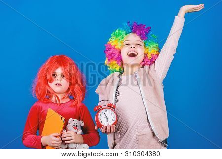 Children Earnest At Their Play. Cute Little Children Wearing Colorful Wig Hair. Adorbale Small Child
