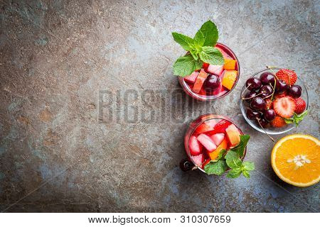 Red Wine Sangria Or Punch With Fruits And Ice In Glasses Top View. Homemade Refreshing Fruit Sangria