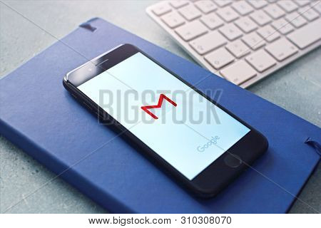 Kharkiv, Ukraine - July 6, 2019: Google Gmail Application On A Smartphone Screen Lying On The Notepa