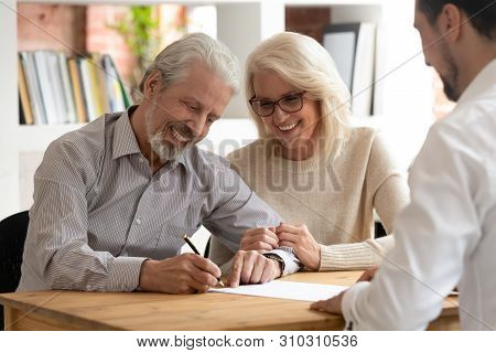 Happy Older Couple Clients Sign Insurance Contract Meeting Agent