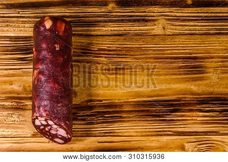 Smoked Salami Sausage On Rustic Wooden Table. Top View