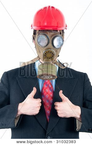 Businessman with gas mask and helmet isolated on white showing thumbs up