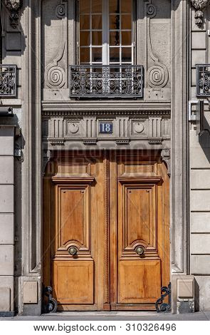 Paris / France - 06 26 2019: Beautiful Antique Double Door Entrance Of Old Building In Paris France.