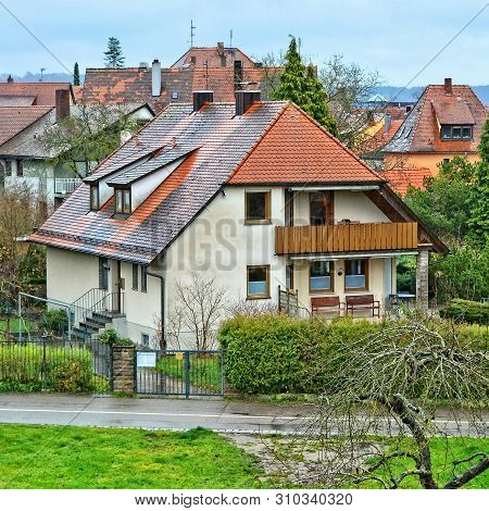 German Architecture. Nice Houses With Red Tile Roofs And Gardens. Germany. Bavaria. Rothenburg Ob De