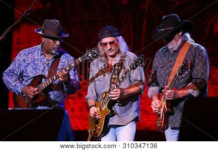 HUNTINGTON, NY - JUN 27: Chris Hicks (C) and Rick Willis (R) of the Marshall Tucker Band perform in concert at the Paramount on June 27, 2019 in Huntington, New York.