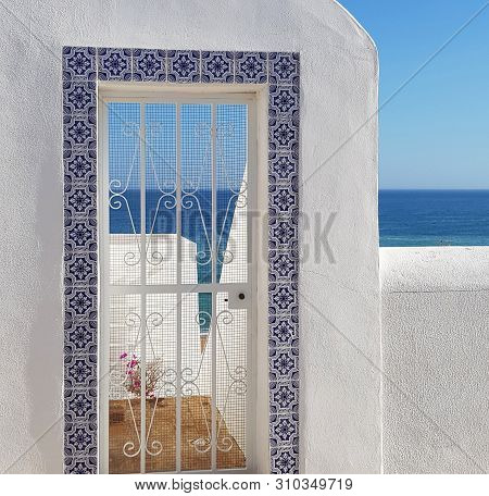 Grated Door Detail, Decorated With Portuguese Azulejo Style Ceramic Tiles