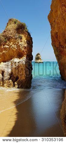 Beautiful Cliffs In Turquoise Atlantic Ocean On The Beach Praia Dona Ana, Lagos, Portugal
