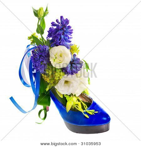 lady's shoe decorated with flowers