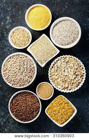 Selection Of Whole Grains In White Bowls - Rice, Oats, Buckwheat, Bulgur, Porridge, Barley, Quinoa,