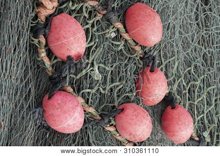 Background Of Fishing Nets And Floats On The Ground