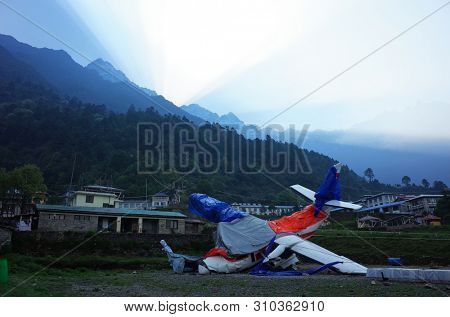Lukla, Nepal - May 8, 2019: Broken small airplane on Tenzing–Hillary Airport - one of most dangerous airports in the world. Summit Air plane crashed and killed 3 people on 14 april 2019