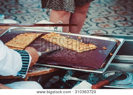Turkish Woman Prepares Gozleme - Traditional Dish In The Form Of Flatbread Stuffed With Greens And C