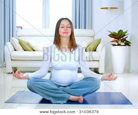 Beautiful Pregnant Woman Doing Yoga at Home