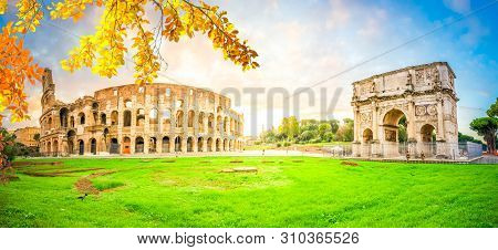 Ruins Of Antique Colosseum And Arch Of Constantine In Sunise Lights, Rome Italy At Fall