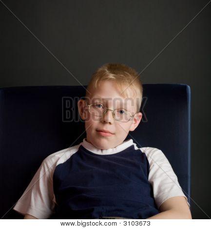 Confident Boy Sit On Chair