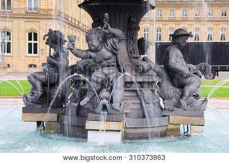 Fountain With Statues Of Children Near The City Attractions. Stuttgart. April 2019
