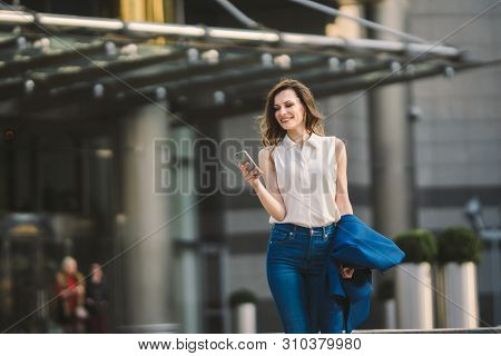 Office Buildings City People In Suit. Caucasian Businesswoman Using Smartphone With Hand. Business C